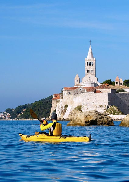 enjoy a sea kayak tour of Rab Island toward Goli Otok