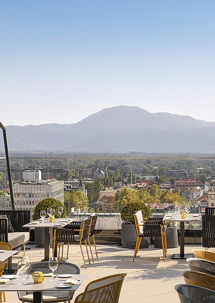 hotel Intercontinental in Ljubljana iis modernly designed with a rooftop terrace featuring a beautiful city view