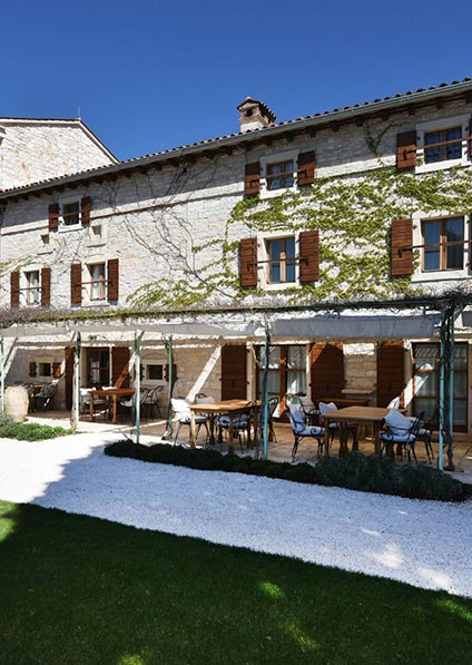 Villa Meneghetti in Bale set in a pictureque place, amidst a vineyard and an olive grove